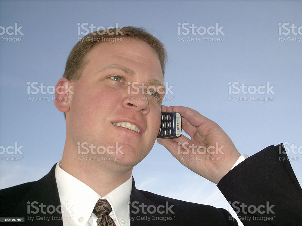 Businessman outside talking on phone stock photo