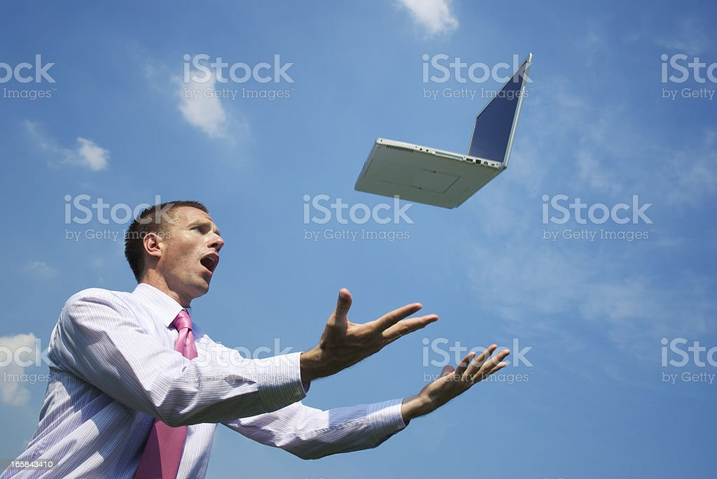 Businessman Panics with Laptop Flying in the Sky royalty-free stock photo
