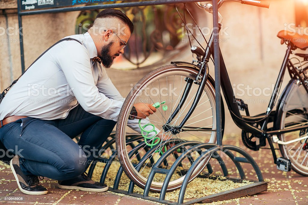 Businessman Parking His Bycycle. stock photo