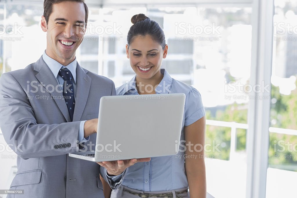 Businessman partners looking at laptop and laughing royalty-free stock photo