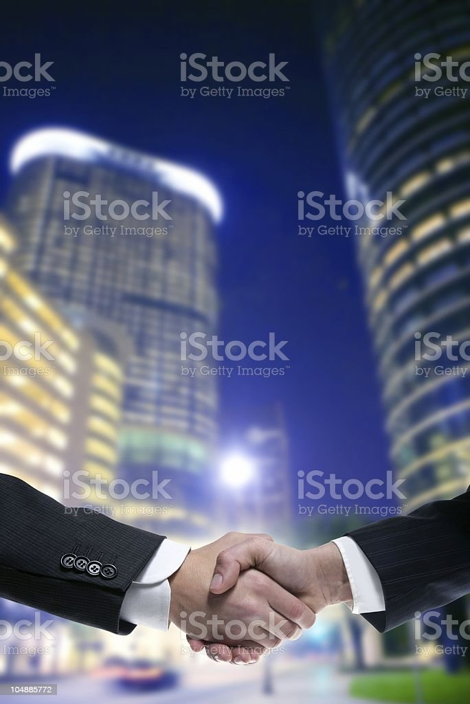 Businessman partners with suit handshake royalty-free stock photo