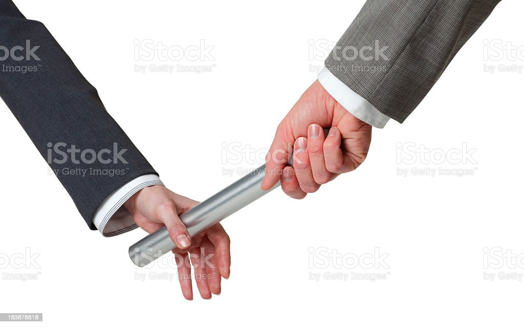 Businessman passing baton to a businesswoman on white background stock photo