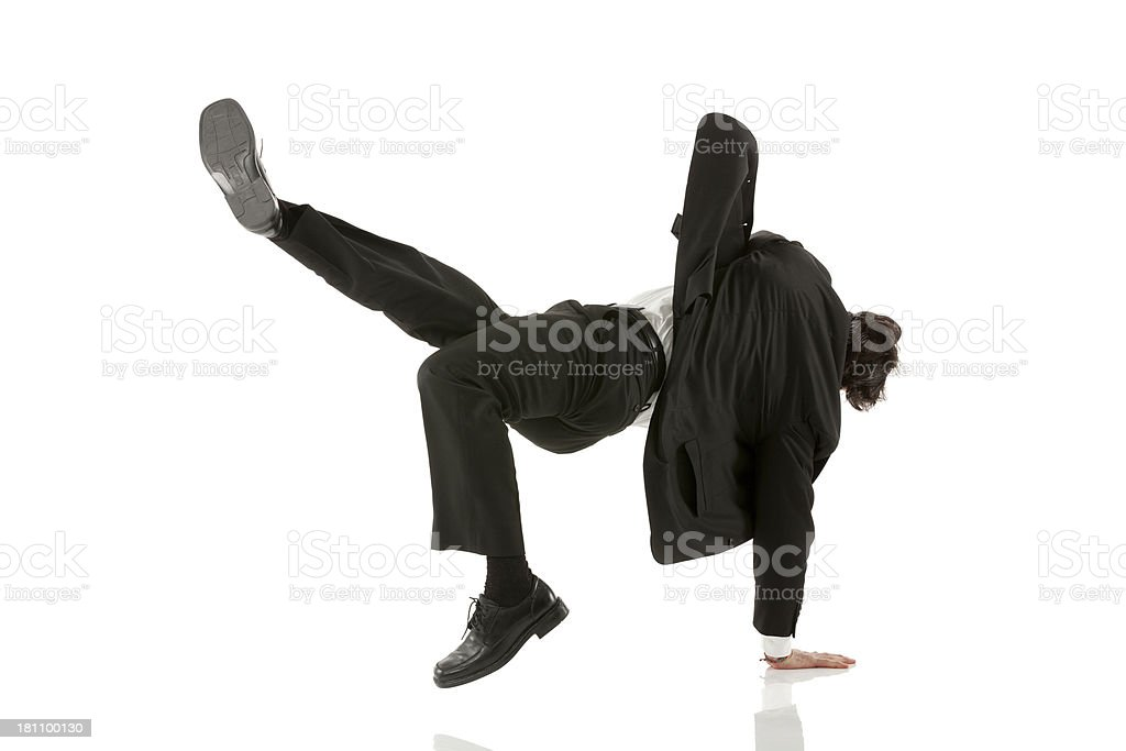 Businessman performing a cartwheel against white royalty-free stock photo