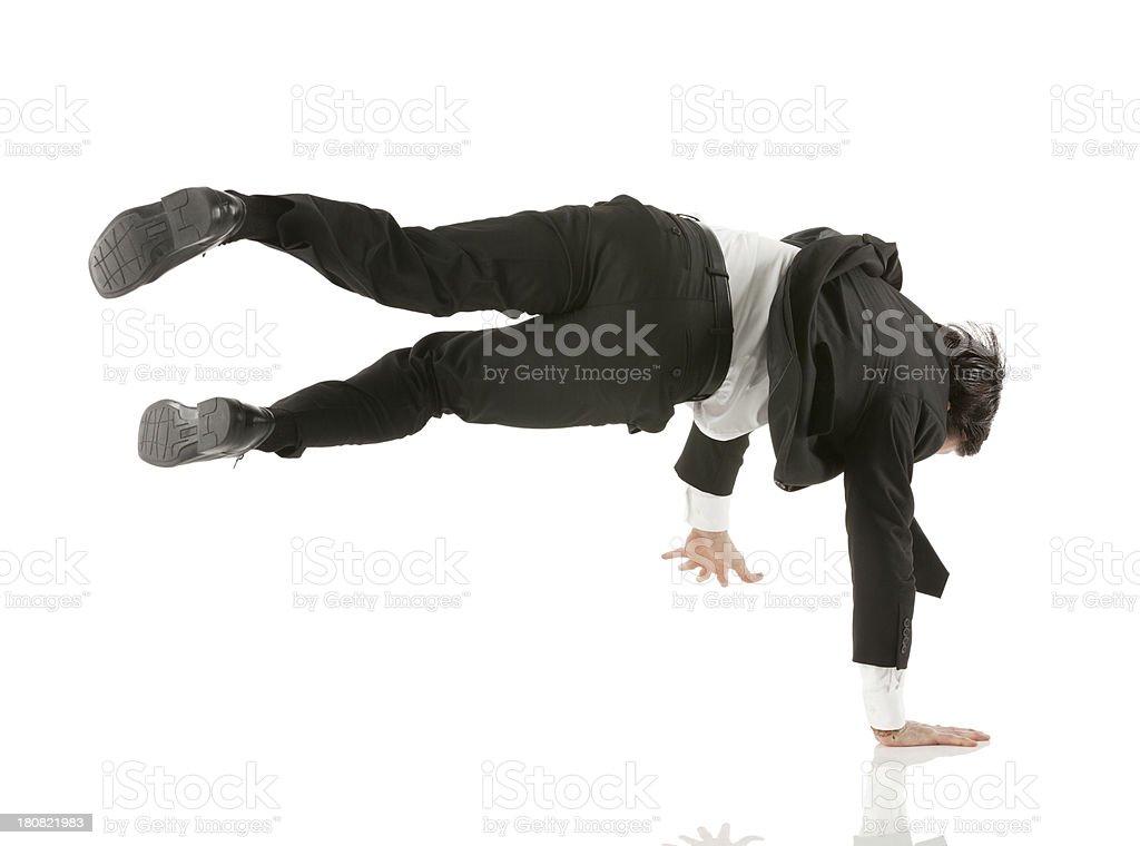 Businessman performing cartwheel stock photo