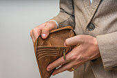 Businessman person holding an empty wallet, no money