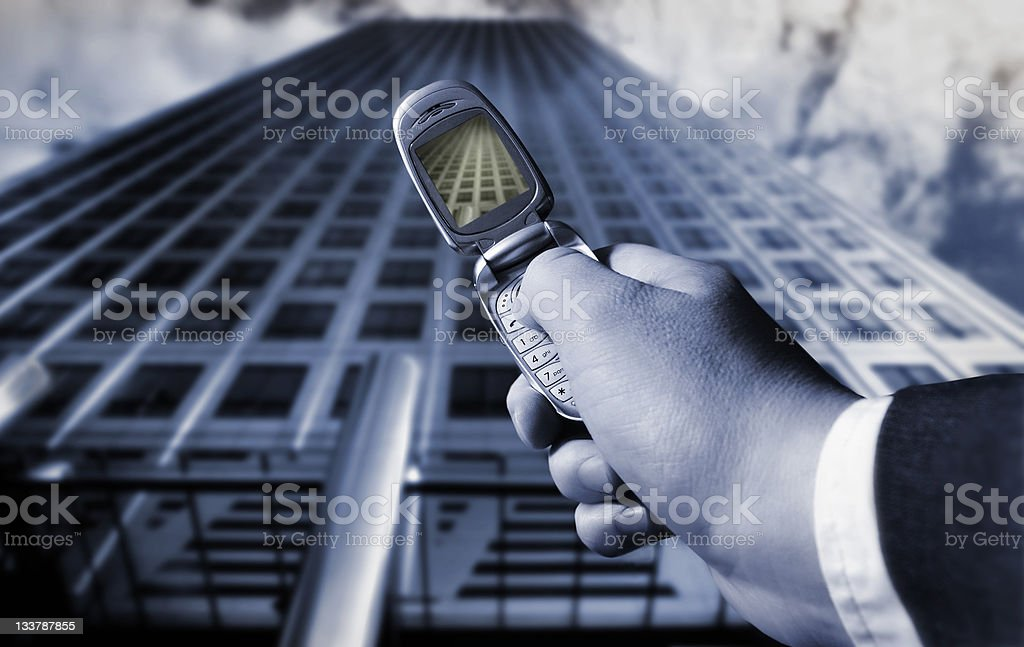 businessman photographing a skyscraper royalty-free stock photo