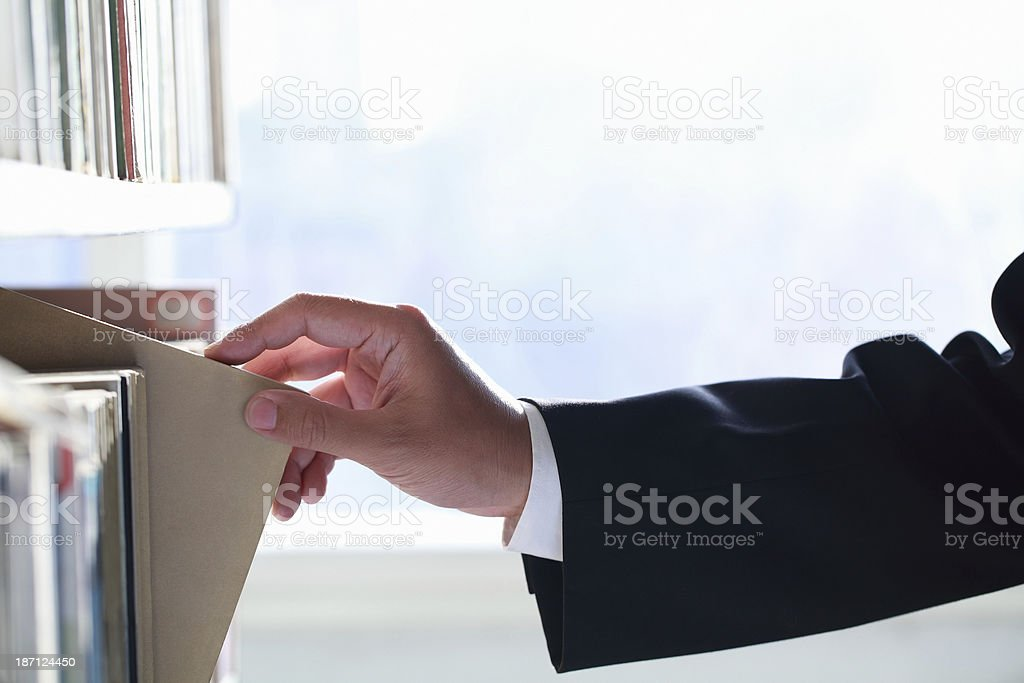 Businessman Picking Book royalty-free stock photo