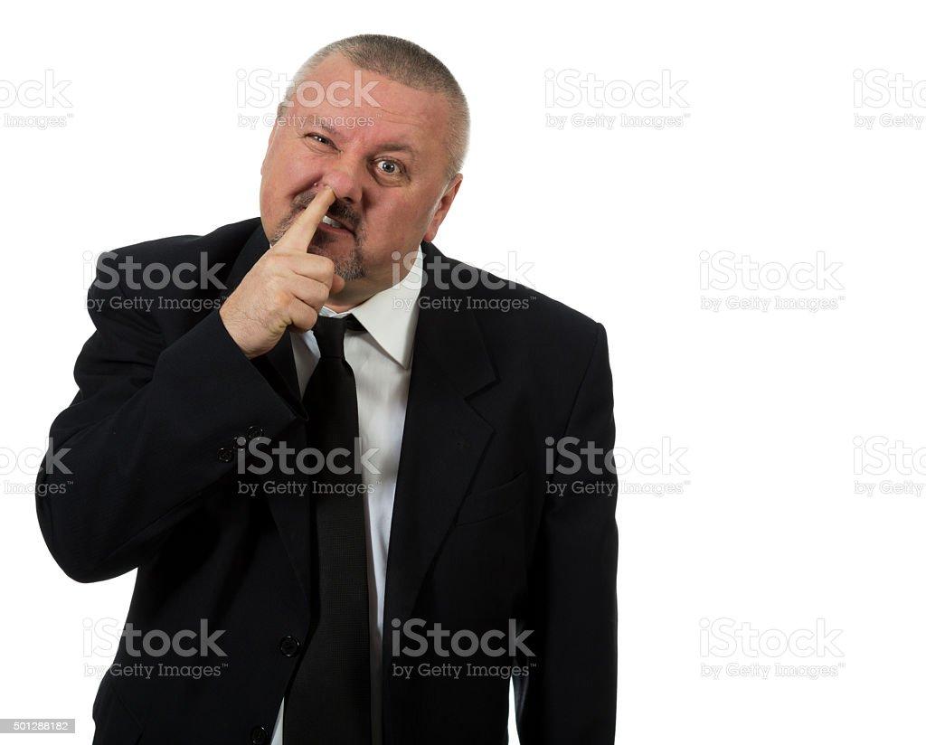 Businessman picks nose stock photo