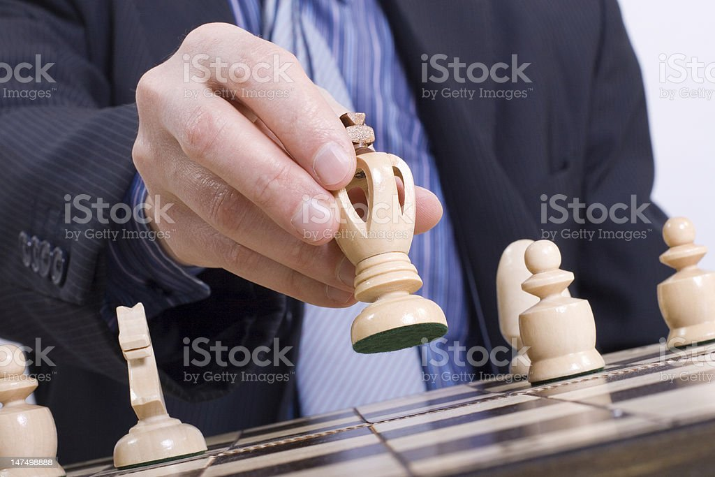 Businessman planning his next chess move stock photo