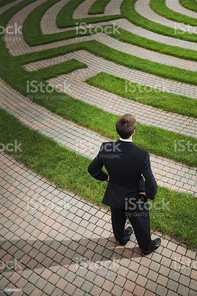 Businessman Planning Strategic Path and Problem Solving Corporate Business Maze stock photo