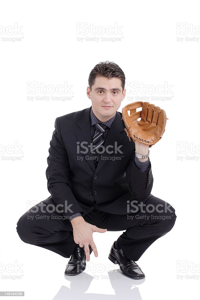 Businessman playing baseball stock photo