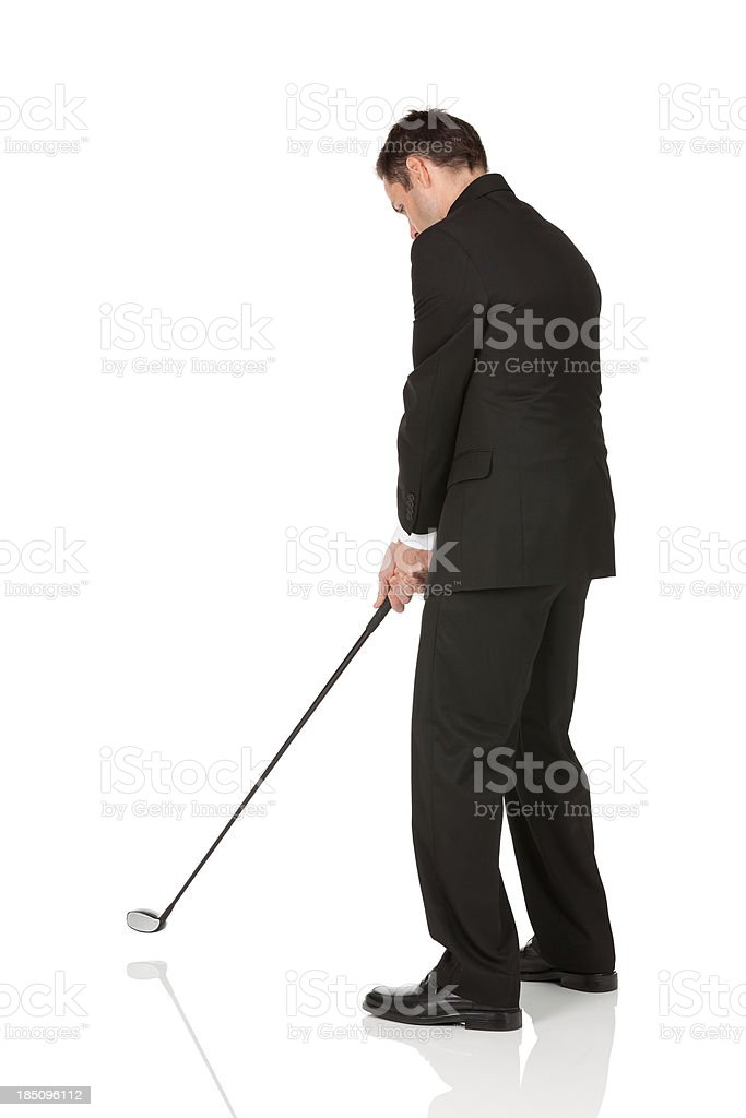Businessman playing golf royalty-free stock photo