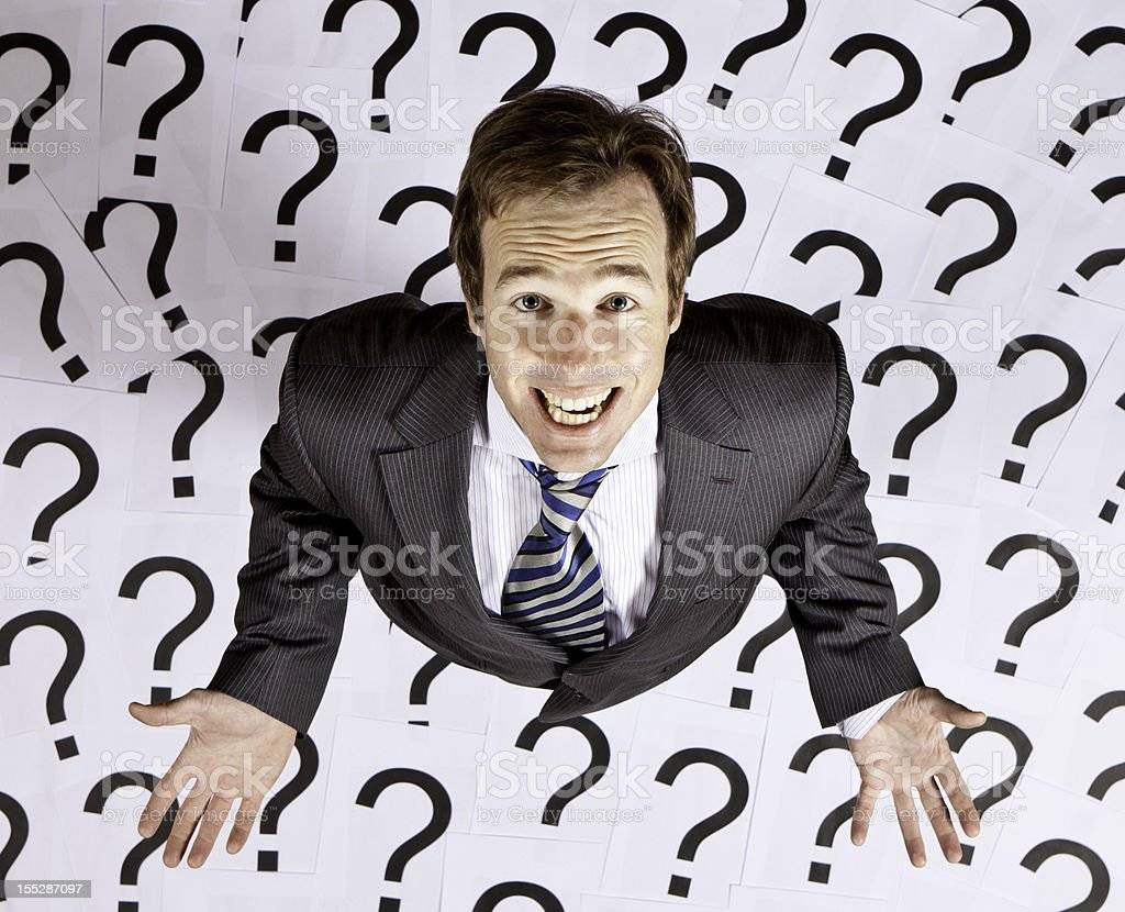 Businessman pleading for answers royalty-free stock photo