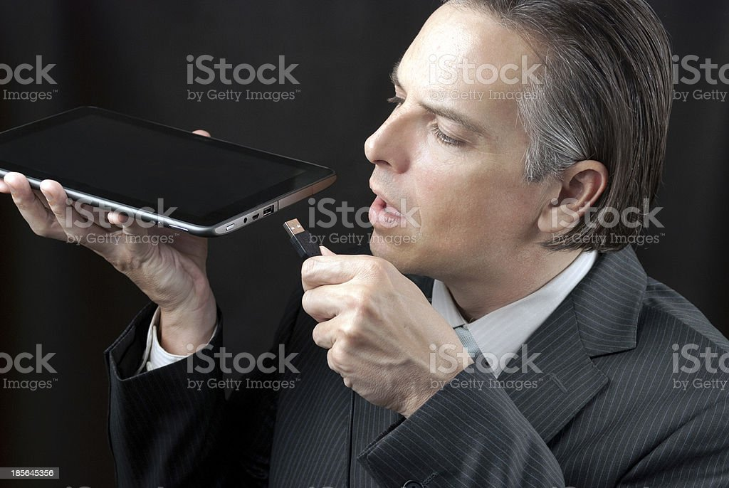 Businessman Plugs In Tablet royalty-free stock photo
