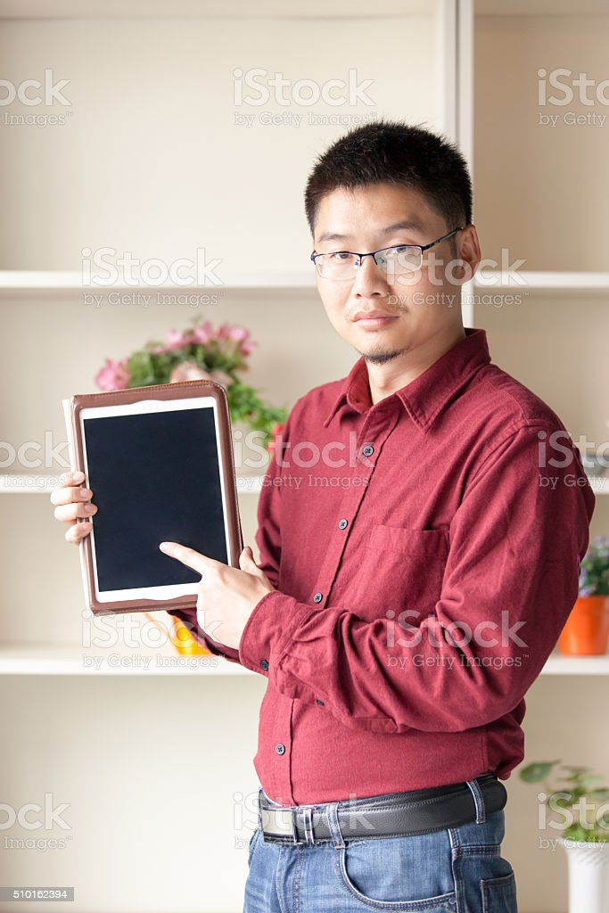 Businessman point at digital tablet in modern office stock photo