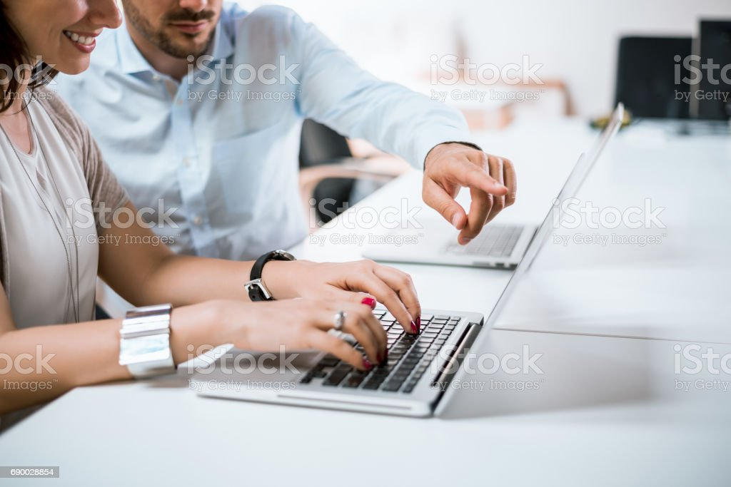Businessman pointed a finger at notebook, boss pointing on funny post on the computer. stock photo