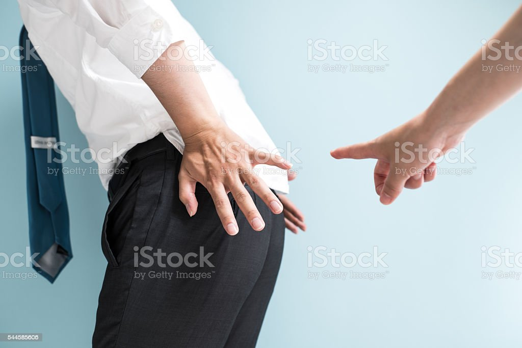 Businessman pointed by colleague stock photo
