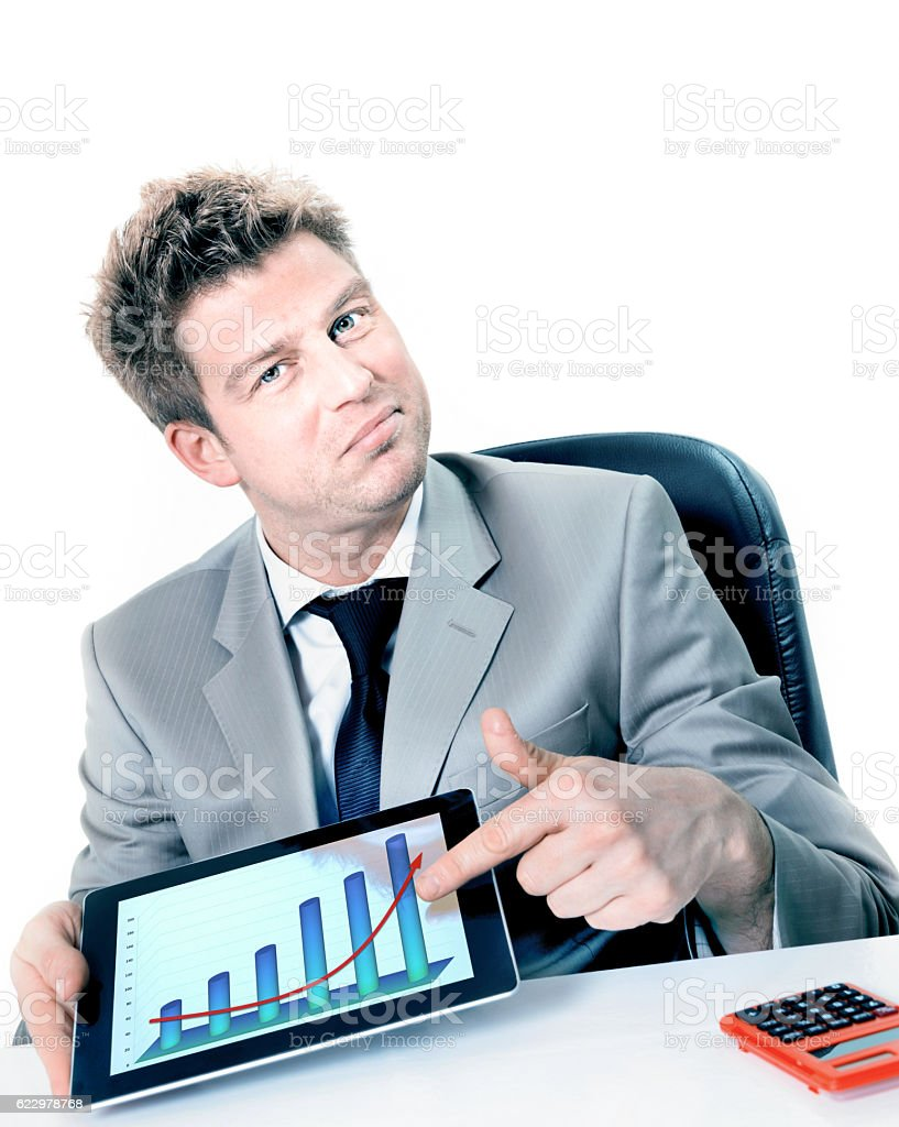 businessman pointing a positive business chart on pad stock photo
