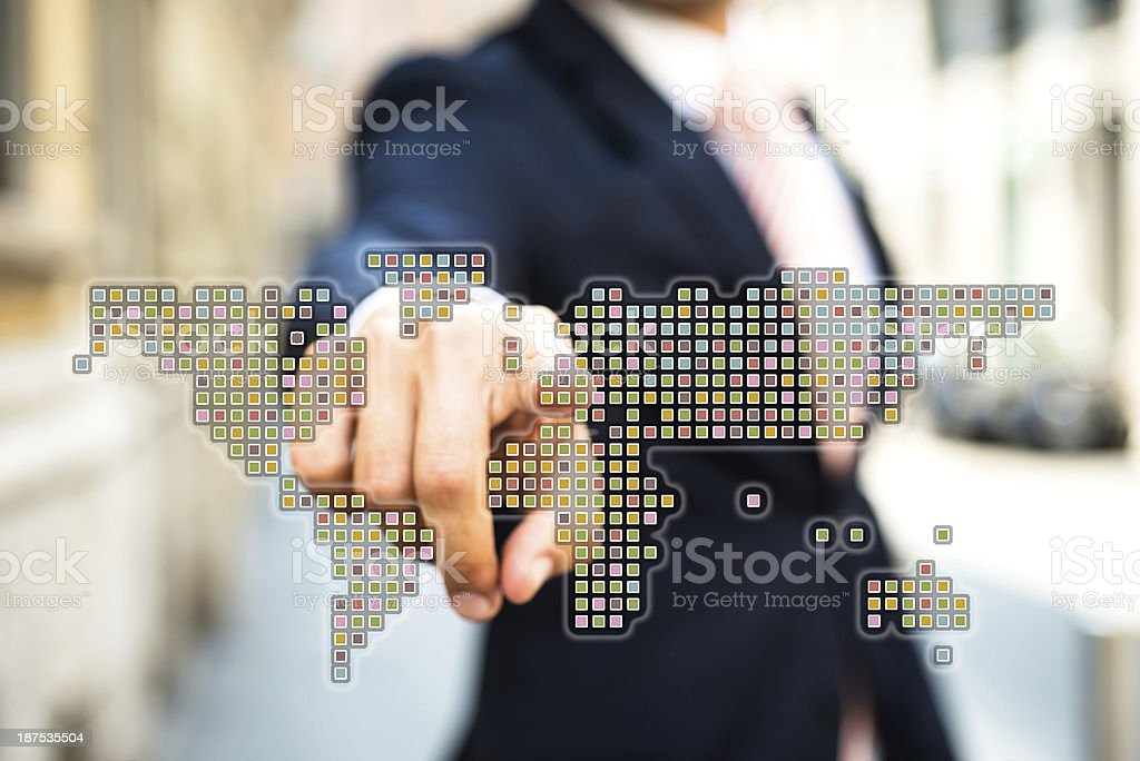 Businessman Pointing a World Map royalty-free stock photo