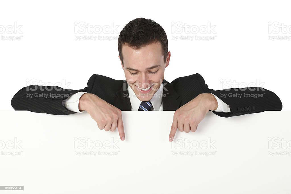 Businessman pointing at a placard royalty-free stock photo