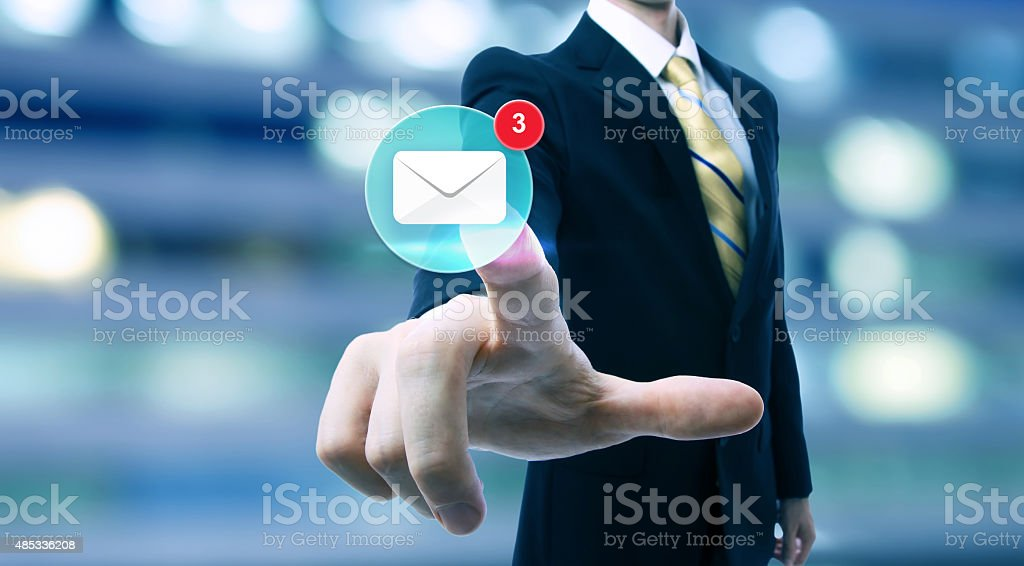 Businessman pointing at an email icon stock photo