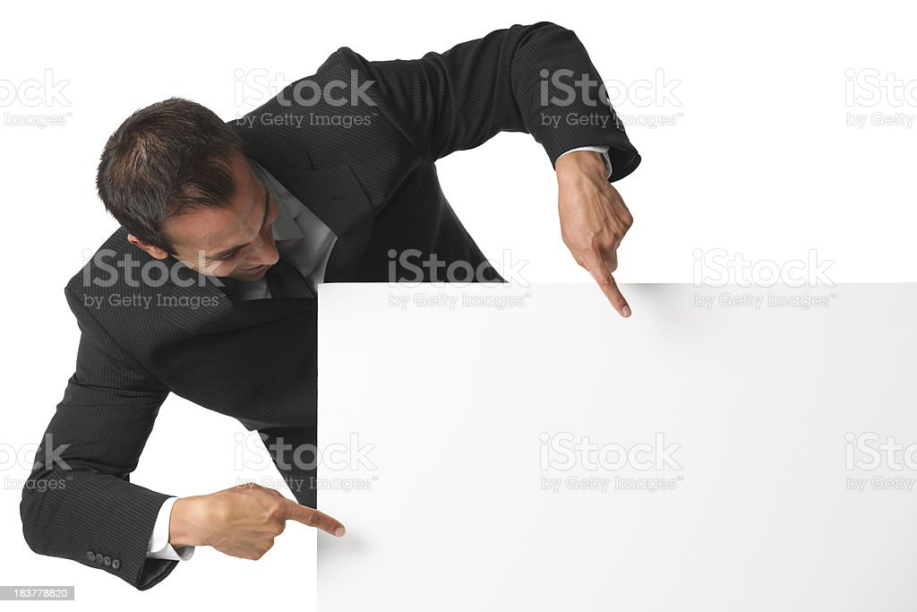 Businessman pointing at blank sign with both hands royalty-free stock photo