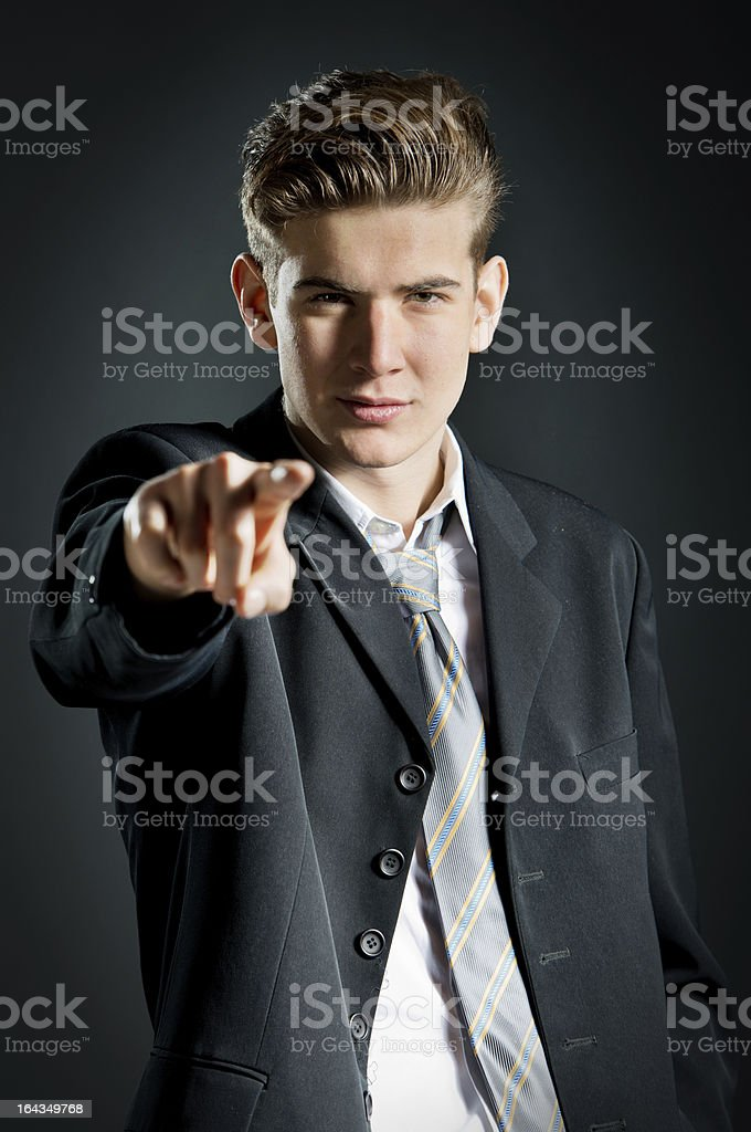 Businessman pointing at camera stock photo