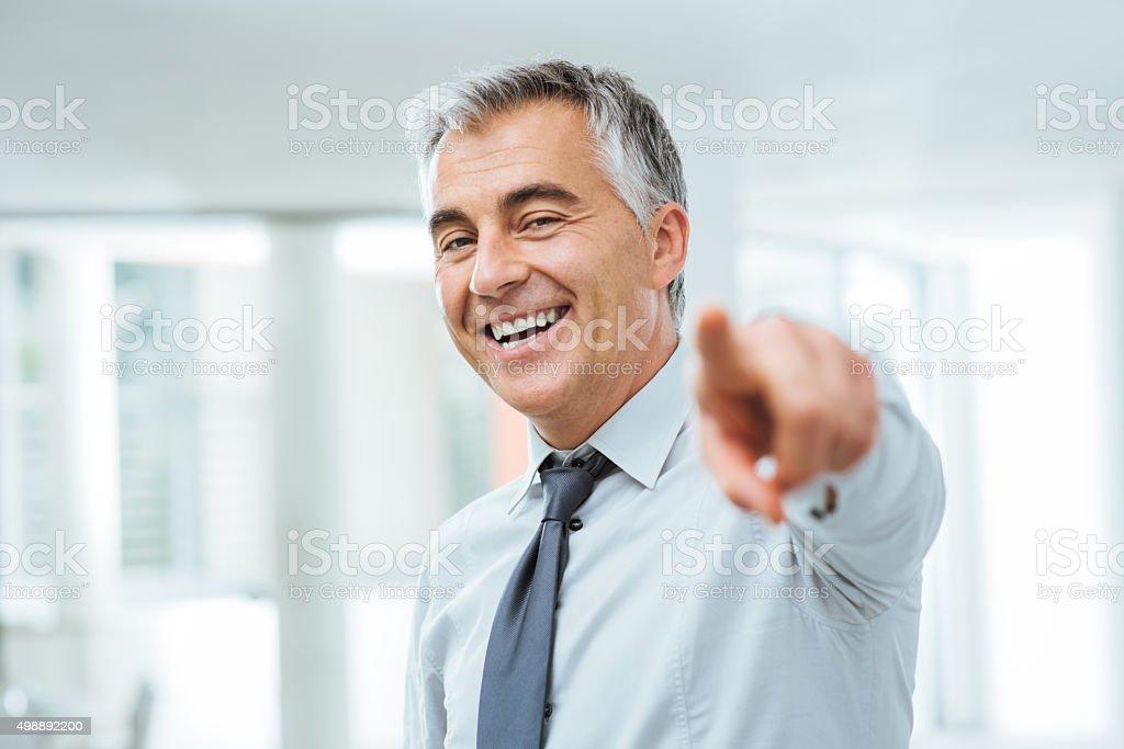 Businessman pointing at camera stock photo