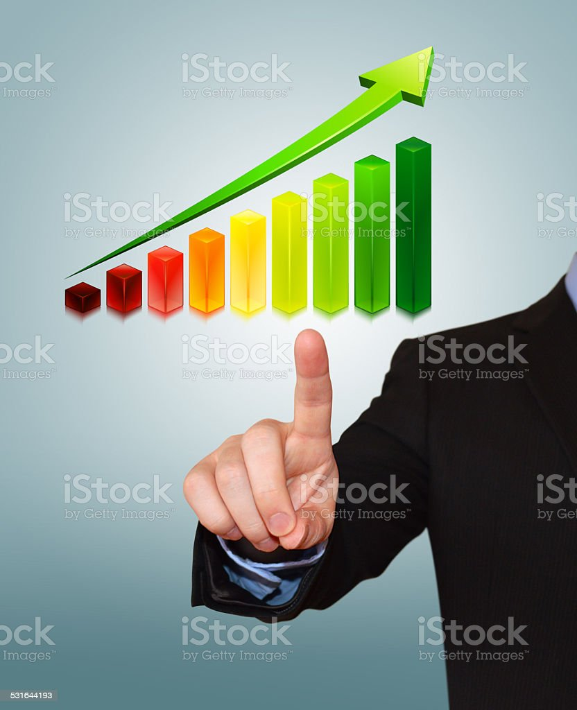 Businessman Pointing at Cubed Graph stock photo