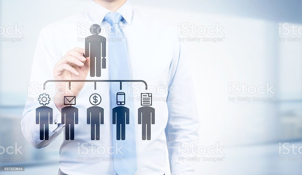 Businessman pointing at delegating pictogram stock photo