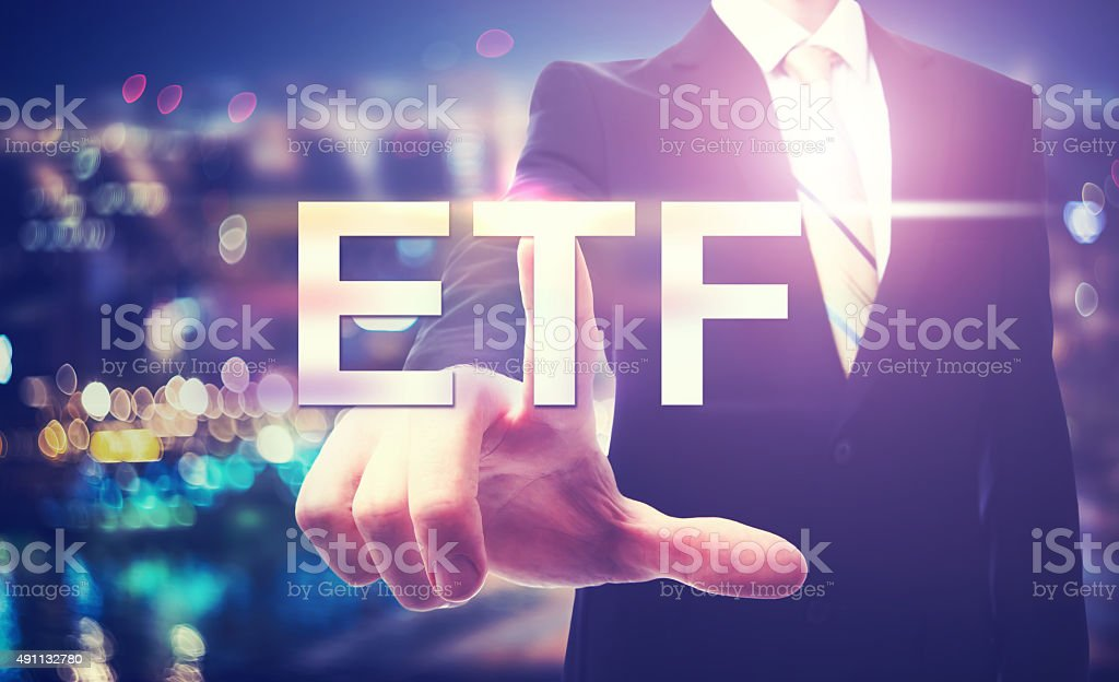Businessman pointing at ETF stock photo