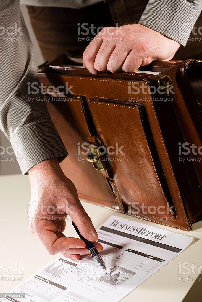 Businessman pointing at financial report royalty-free stock photo