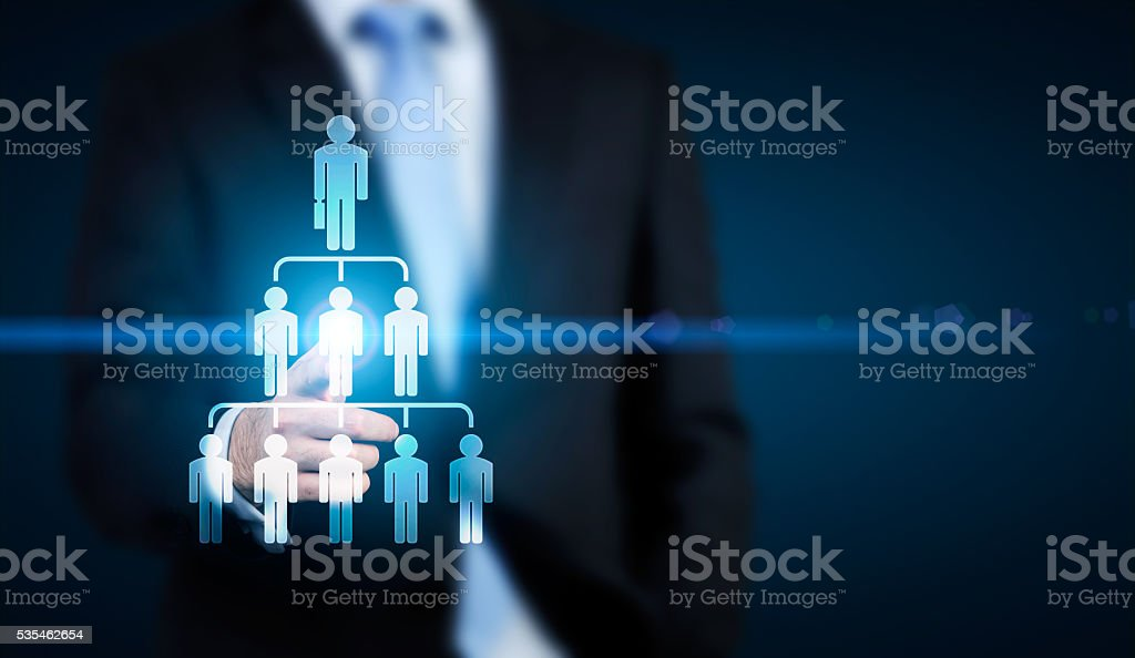 Businessman pointing at hierarchy stock photo