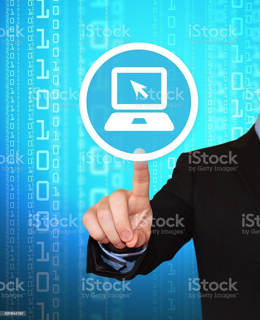 Businessman Pointing at Laptop on Binary Background stock photo