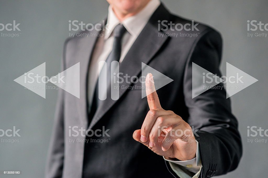 businessman pointing at Playing Touch Screen stock photo