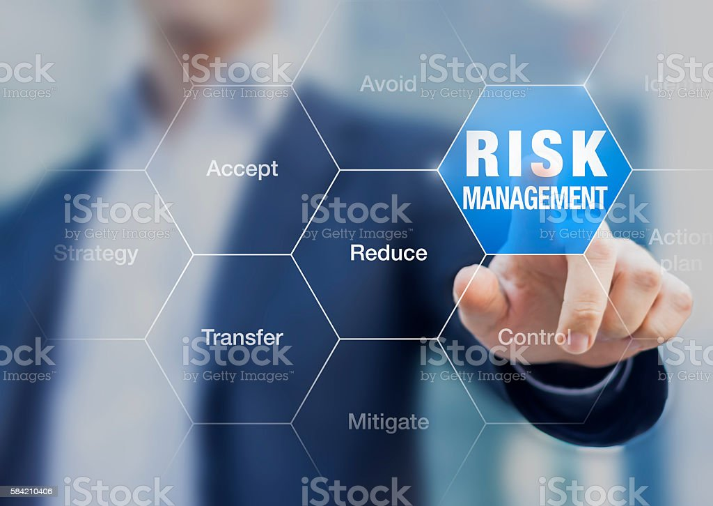 Businessman pointing at risk management concept on screen stock photo