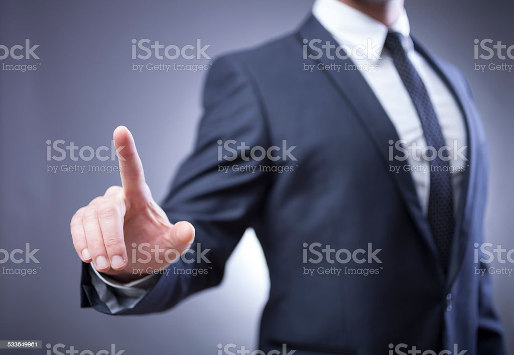 businessman pointing at virtual display stock photo