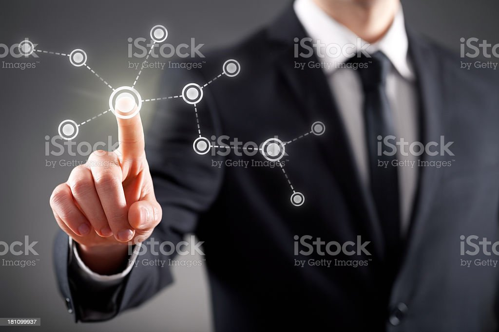 Businessman pointing at visual touch screen stock photo
