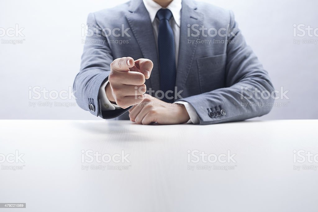 Businessman Pointing at You stock photo