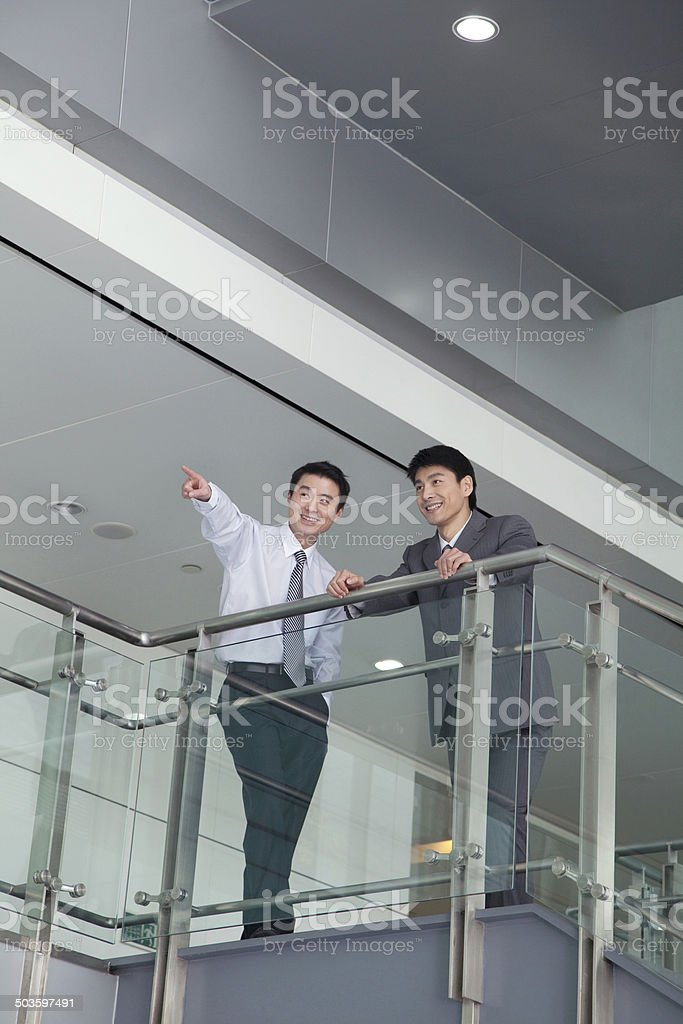 Businessman Pointing by Rail royalty-free stock photo
