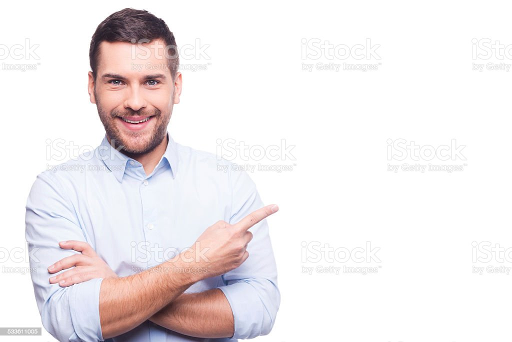 Businessman pointing copy space. stock photo