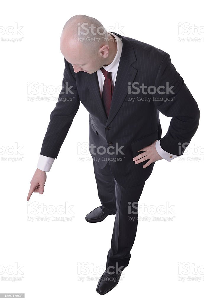 businessman pointing down stock photo