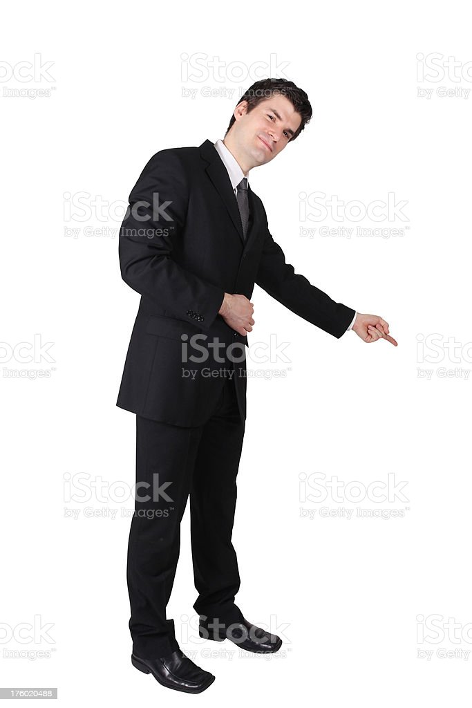 Businessman pointing downward stock photo