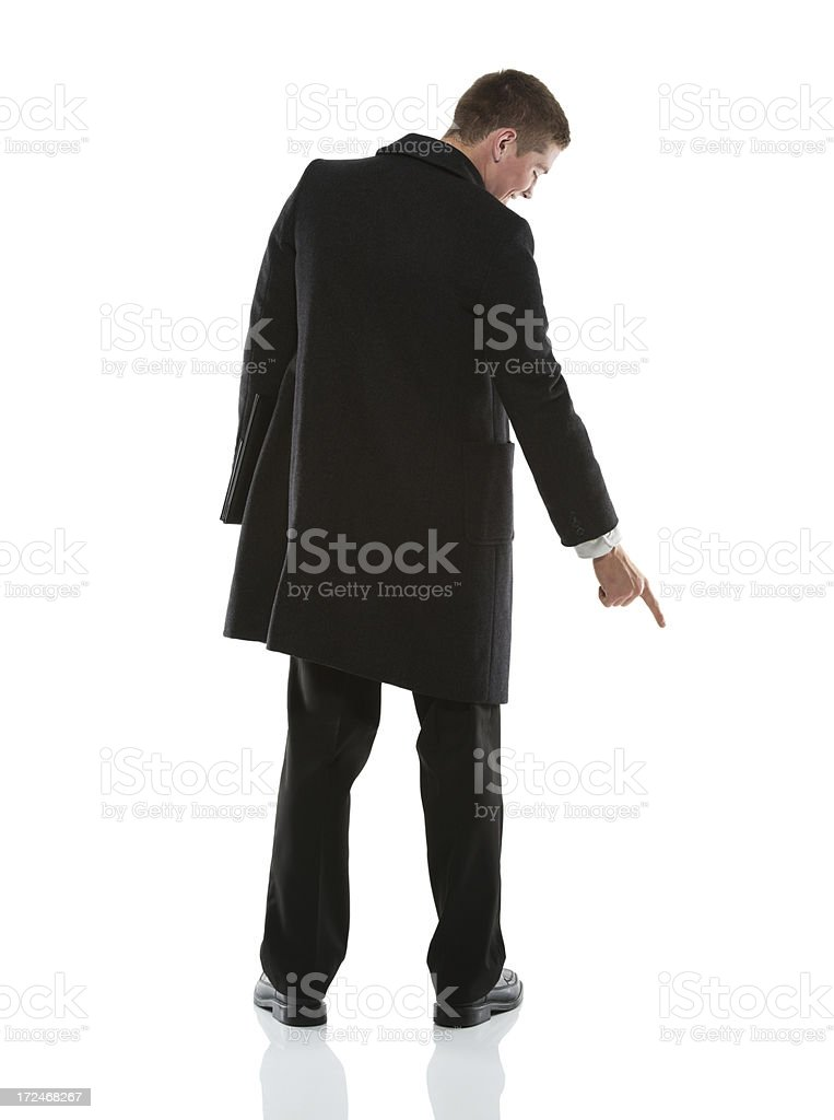 Businessman pointing downward with finger stock photo