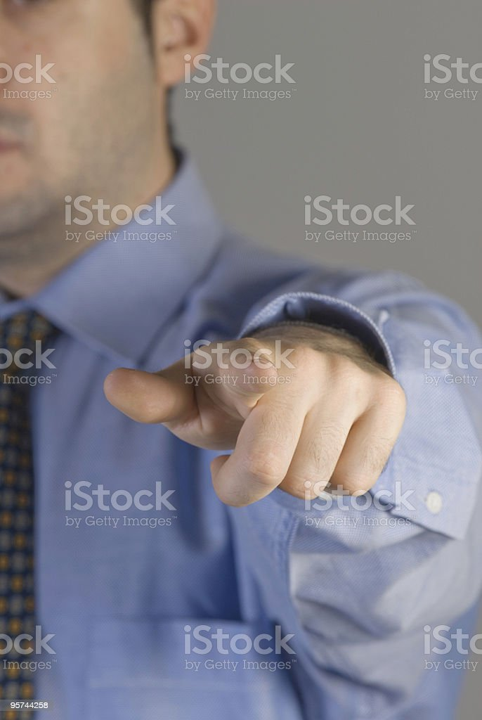 Businessman pointing finger, close-up royalty-free stock photo
