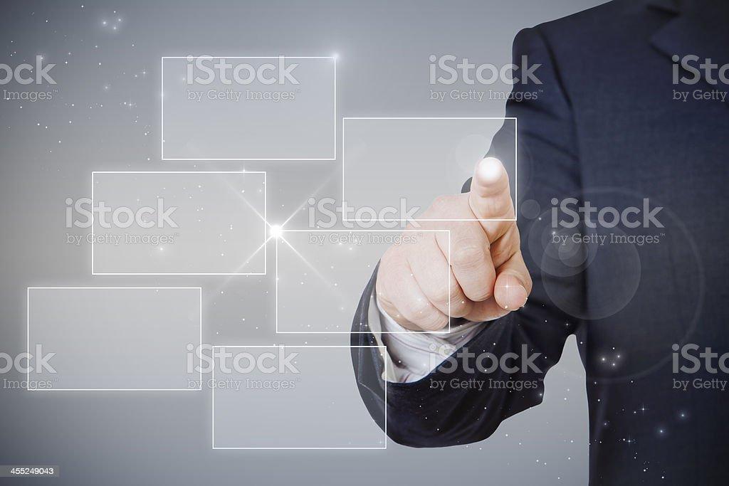 businessman pointing hologram stock photo