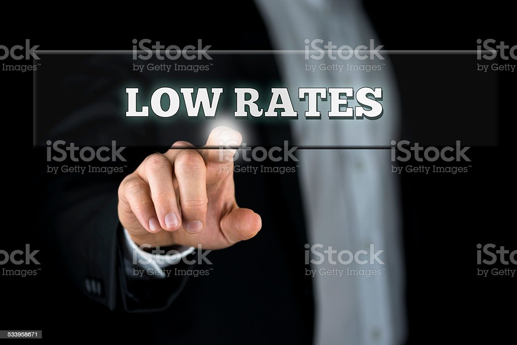 Businessman Pointing Low Rates on Transparent Box stock photo