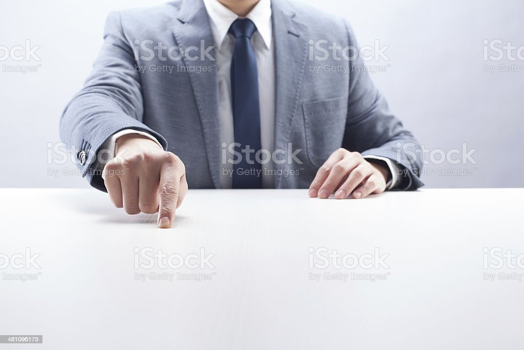 Businessman Pointing on Desk stock photo