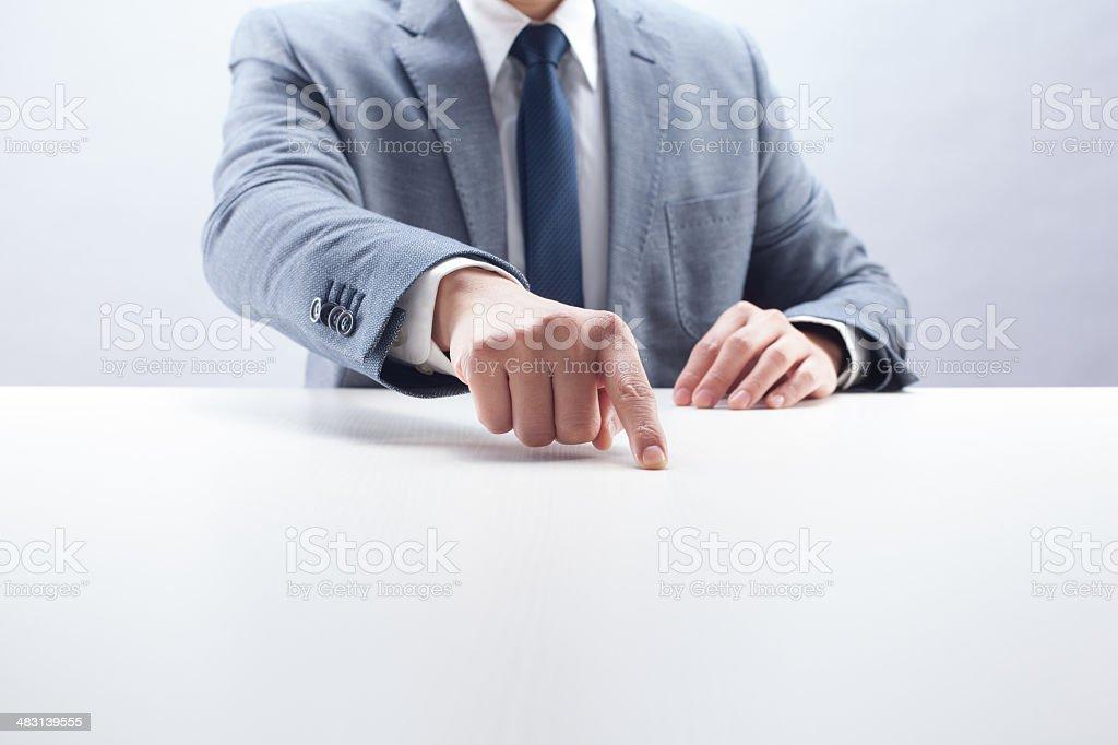 Businessman Pointing on Desk stock photo