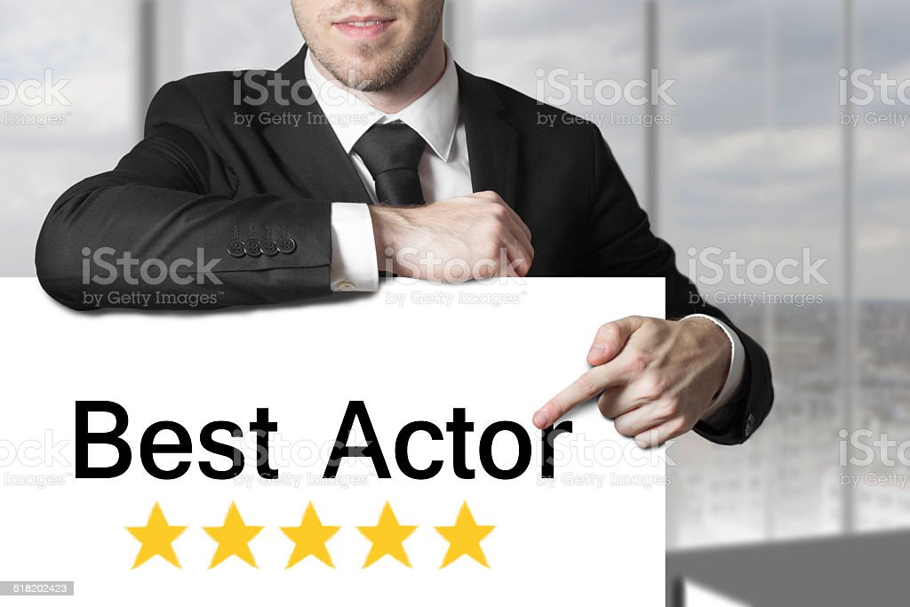 businessman pointing on sign best actor golden rating stars stock photo